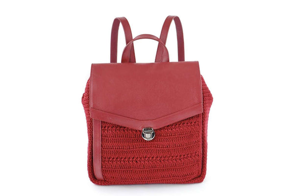 Mulberry Red crochet backpack with genuine leather flap-over closure. Adjustable leather ribbon straps, with a similar looking carry handle loop. Concealed external zipped compartment. Dowa metal silver logo attached to the side crocheted panel of bag.
