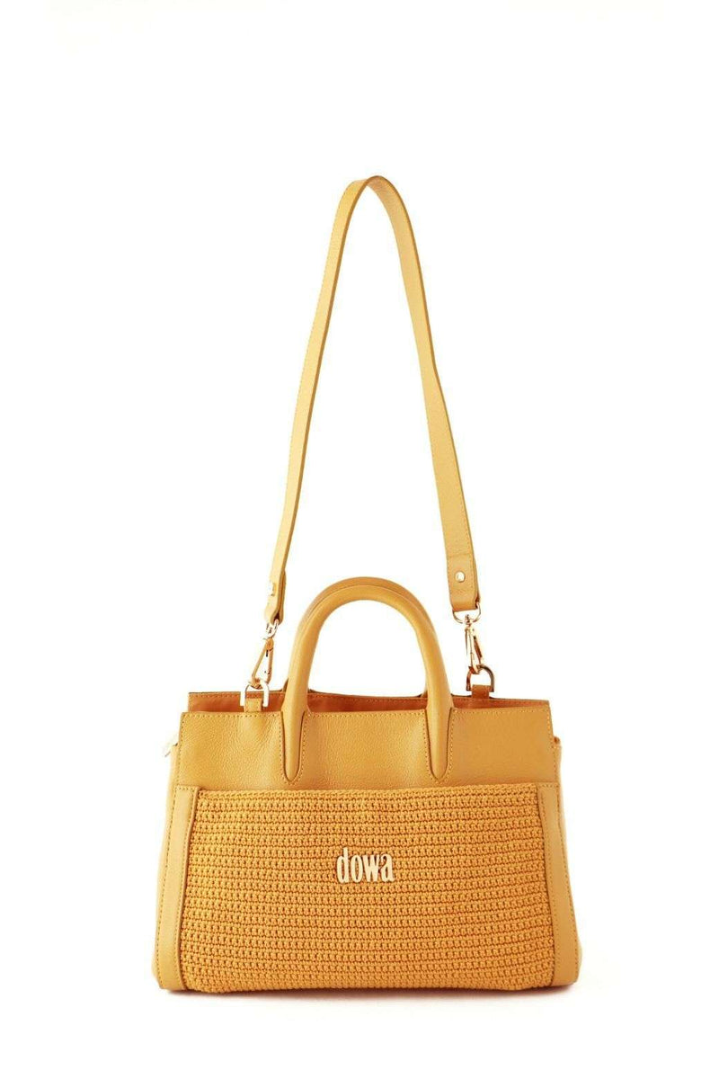 Yellow/Nugget Gold hand-crafted ladies handbag, with a detachable shoulder strap and dual top tubular handles. Crochet style on the exterior and a Dowa metal silver logo attached on the centre. Discrete external zip at the top.