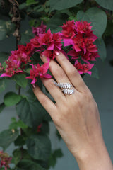 Picture of a crystal adjustable leaf ring on a model's hand.