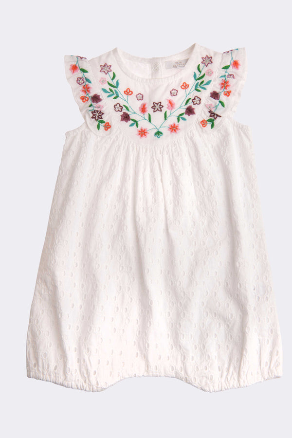 White sleeveless romper outfit with floral front pattern