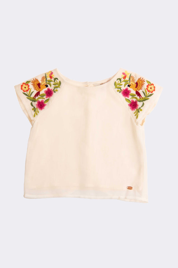 White girls top with capped sleeves and floral design on both shoulders