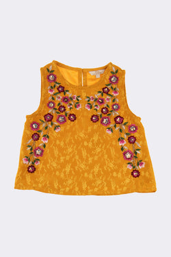 Girls sleeveless mustard top with floral embroidery throughout