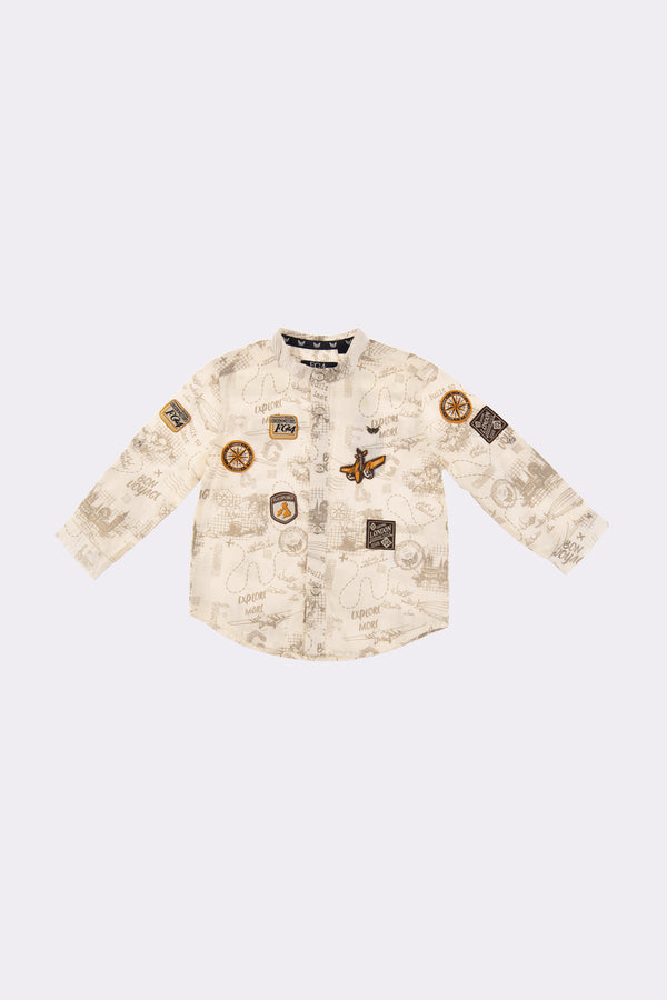 Boys long sleeve shirt with front opening buttons and badge decal throughtout.