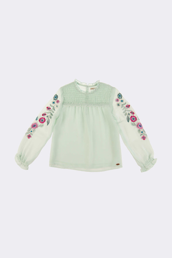 Long sleeve, aqua coloured blouse with floral embroidery on the arms