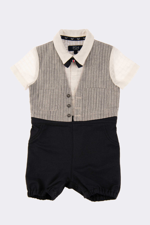 A small 3 in 1 outfit with a white shirt, grey waistcoat and navy trousers