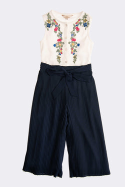 White sleevless floral embroidery top with Navy full length trousers