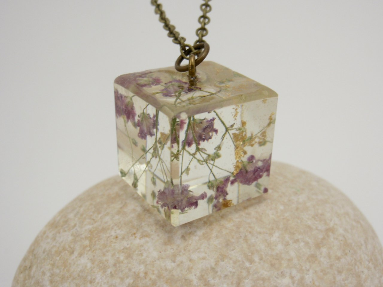 Cube shaped transparent eco resin necklace with real baby's breath flowers and golden leaves