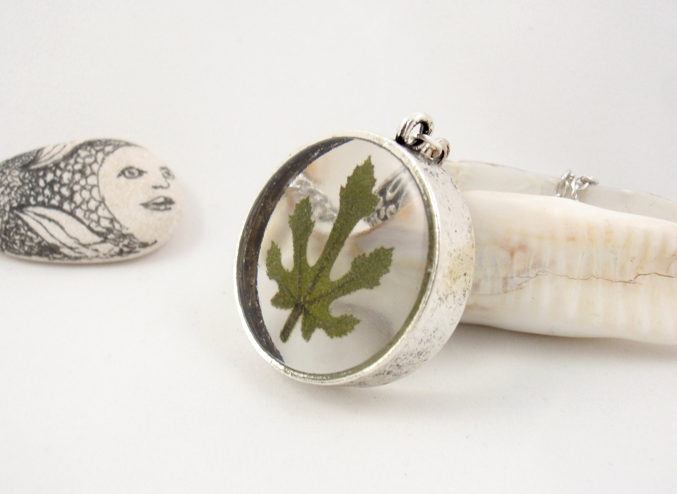 Tiny fig leaf in transparent resin pendant