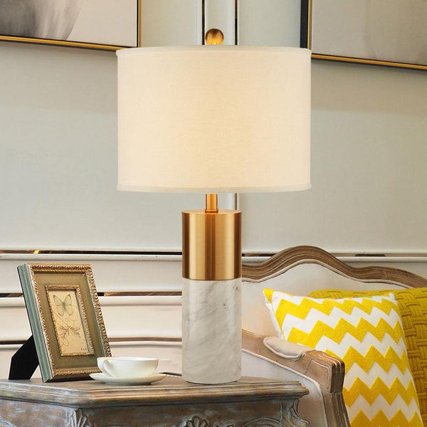 The State gold and white marble pedistal lamp with white lamp shade.