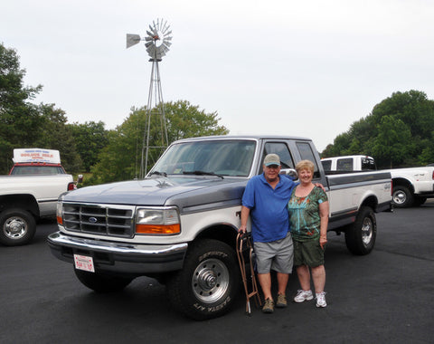 W. Dale O. happily standing with their new purchase.
