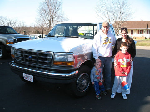 Erik W. and his family with their beautiful new truck from Handpicked Trucks.