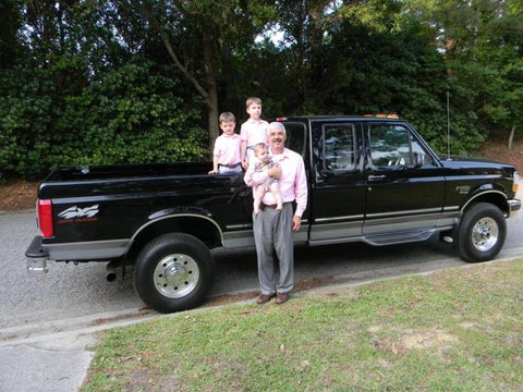Gregg A. standing with his dream truck!  A beautiful 41k mile OBS Ford purchased here at Handpicked Trucks.