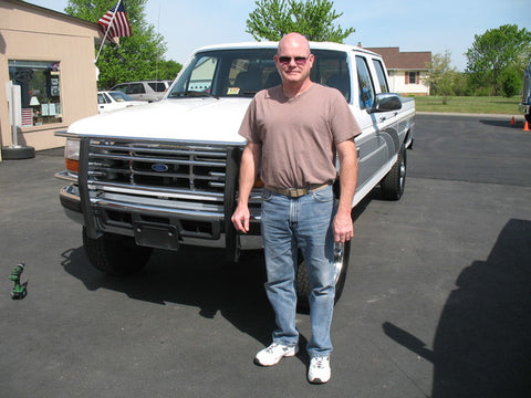 Chris D. standing with his crew cab short bed.  Chris is the second person in his family to purchase from Handpicked Trucks.
