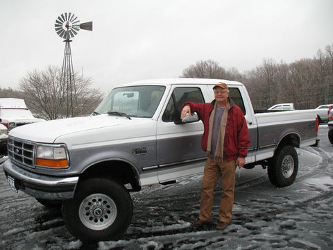 John C. from Burbank California standing with he new 7.3L powerstroke diesel he purchased from Handpicked Trucks.