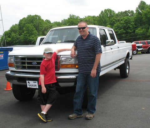 Ian L. proudly standing with his new crew cab long bed 1996 F350 Powerstroke Diesel