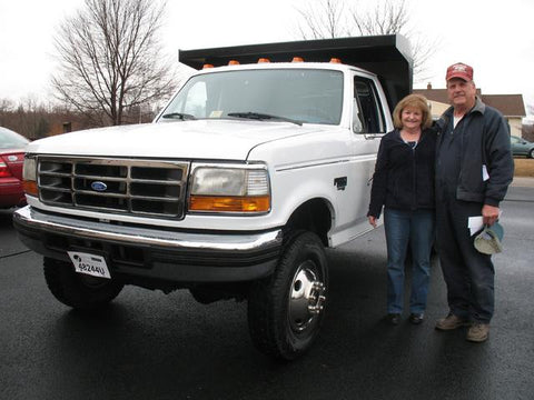 Thomas and Goldie M. with their new dump truck.