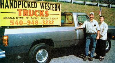 Mark & Colleen standing with a first gen dodge front Handpicked Western Trucks