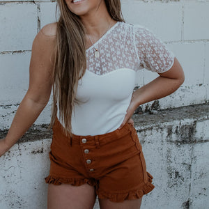 BUTTERSCOTCH RUFFLE HEM DENIM SHORTS