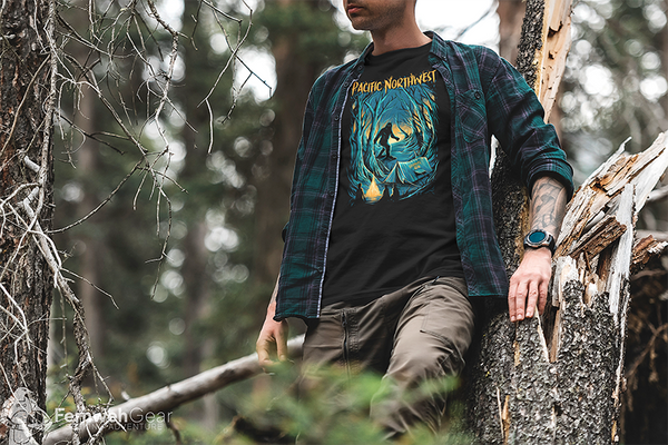 Man in forest wearing Campfire Tales unisex black sasquatch camping shirt by Fernweh Gear
