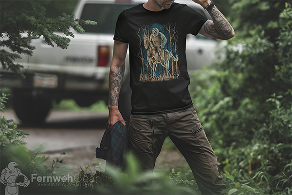 Fernweh Gear man wearing Midnight Encounter unisex shirt in forest