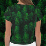 Back view woman wearing Woken Pine all-over-print crop top women's shirt - Fernweh Gear