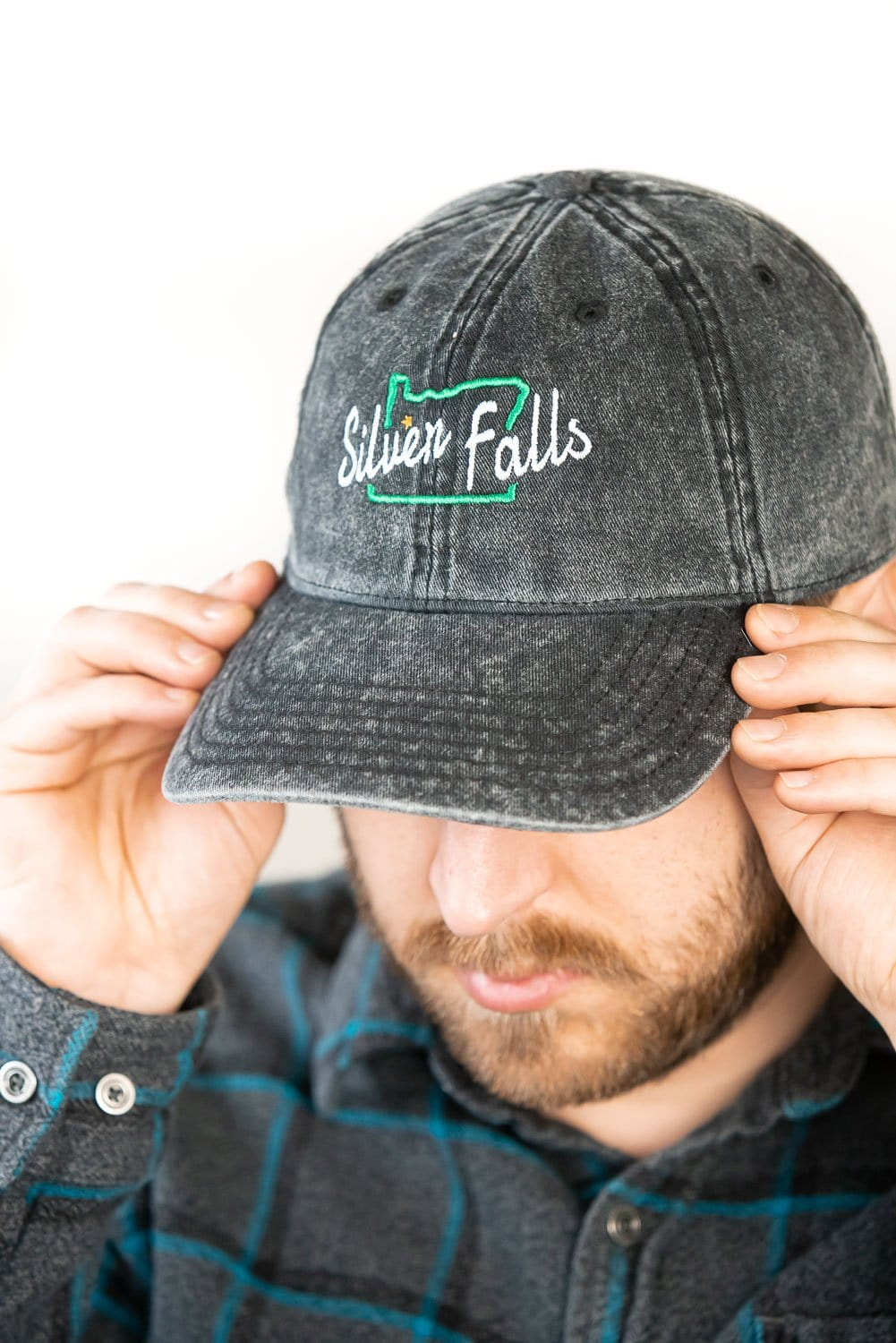 Front view Silver Falls distressed dad hat unisex, black