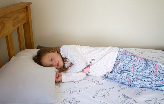 Girl Asleep on Dinosaur Brolly Sheet