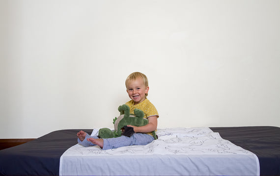 Child sitting on Brolly Sheet
