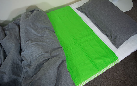 photo of green brolly sheet