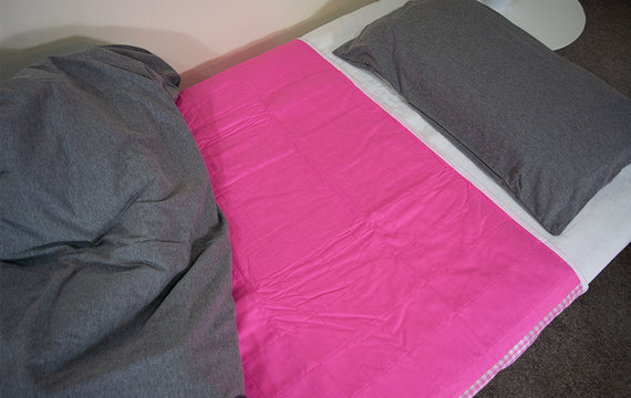 Pink Brolly Sheet on Bed