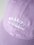 REALITY IS BORING CAP