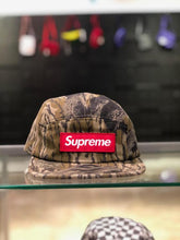 Load image into Gallery viewer, Supreme Military Camp Cap Mossy Oak Camo