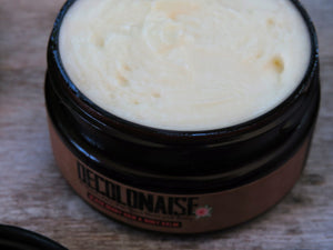 black berry hair and body balm in a jar with the lid open showing creamy texture