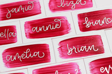 Load image into Gallery viewer, Acrylic place cards with hand-lettered names and rose-coloured painted backs.