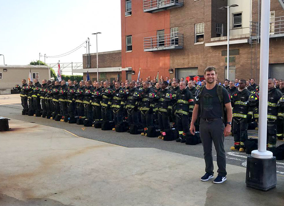 RopeSafe founder Jon Norton standing in front of a group of fire fighters preparing to use RopeSafe rope edge protection devices.