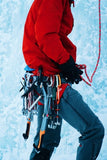 Man with ice climbing tools getting ready to mountain climb