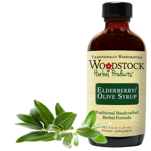 A bottle of Woodstock Herbal Products Elderberry Olive Syrup