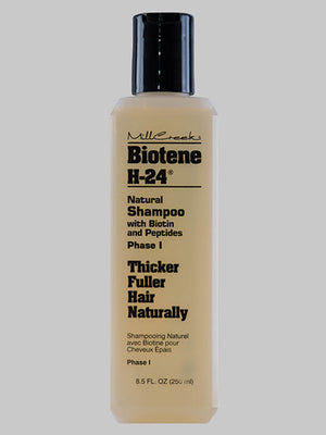 A bottle of Millcreek Botanicals Biotene H-24® Natural Shampoo