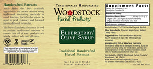 A label with additional information and supplemental facts for Woodstock Herbal Products Elderberry Olive Syrup