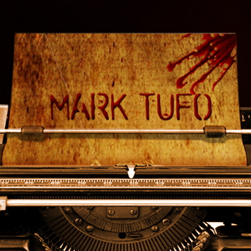 Typewriter with the name Mark Tufo on the piece of paper in it