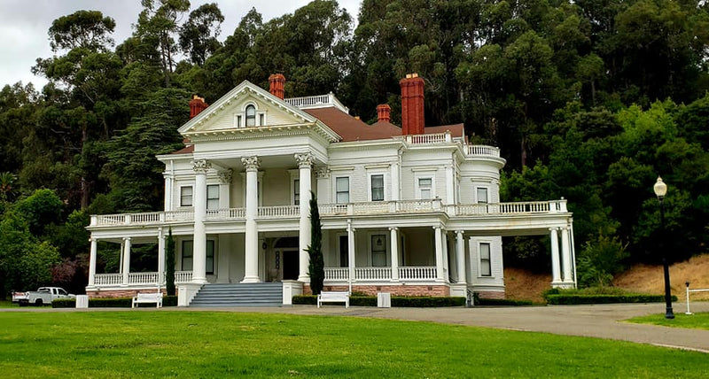 Large, white Dunsmuir House in Oakland Ca