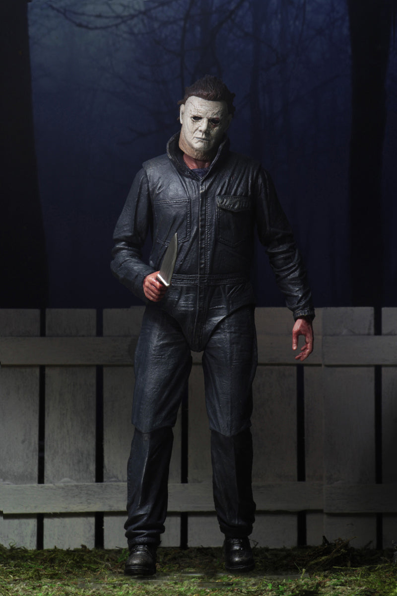 "This is a Halloween 2018 Michael Myers NECA 7"" ultimate action figure and he has a white mask, grey coveralls and black boots."