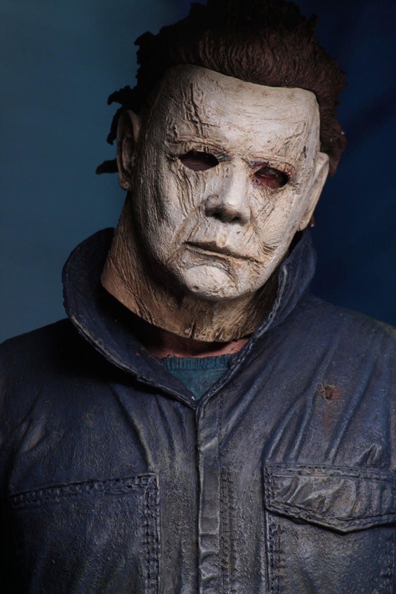 "This is a Halloween 2018 Michael Myers NECA 7"" ultimate action figure and he has a white mask and grey coveralls."