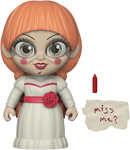 Annabelle 5 Star Funko is standing in a white dress, with a red sash and braids, and has a red crayon and a note that says miss me.
