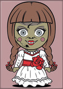 This is a chibi magnet of Annabelle, who is wearing a white dress with a red bow and she has brown braids.