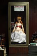 Annabelle NECA from the Conjuring is sitting in a glass display case on a rocking chair and has 2 heads.