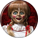 This is an Annabelle button and she has a white dress, braids with red ribbons, red cheeks and lips and she is in front of a red background.