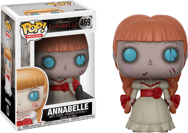 This is an Annabelle Pop Vinyl Funko and she is wearing a white dress that has a red bow, with braids, blue eyes and a red cut on her face.