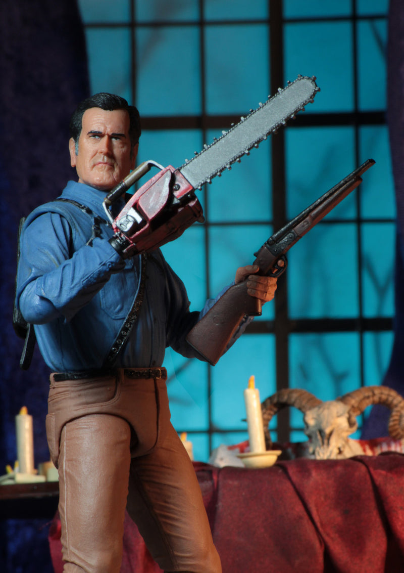 "This is an Ash vs Evil Dead 7"" Intimate NECA action figure with blue shirt, tan pants and he is holding a chainsaw and shotgun."