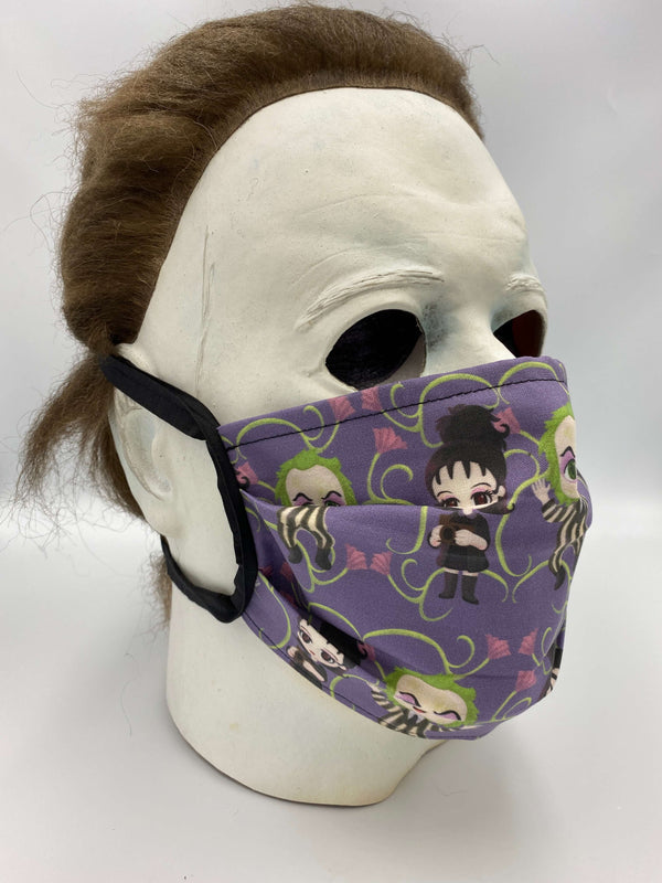 This is a purple Beetlejuice protective face mask that includes Lydia Deetz and had green vines with pink flowers and he has a black and white striped suit and it is on Michael Myers.